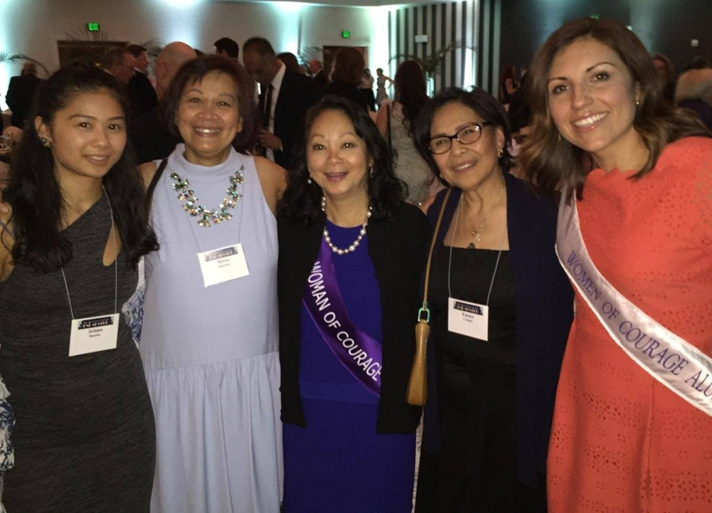 The healthcare expert (center) after receiving the Woman of Courage Award from the University of Washington in 2017. CONTRIBUTED PHOTOS