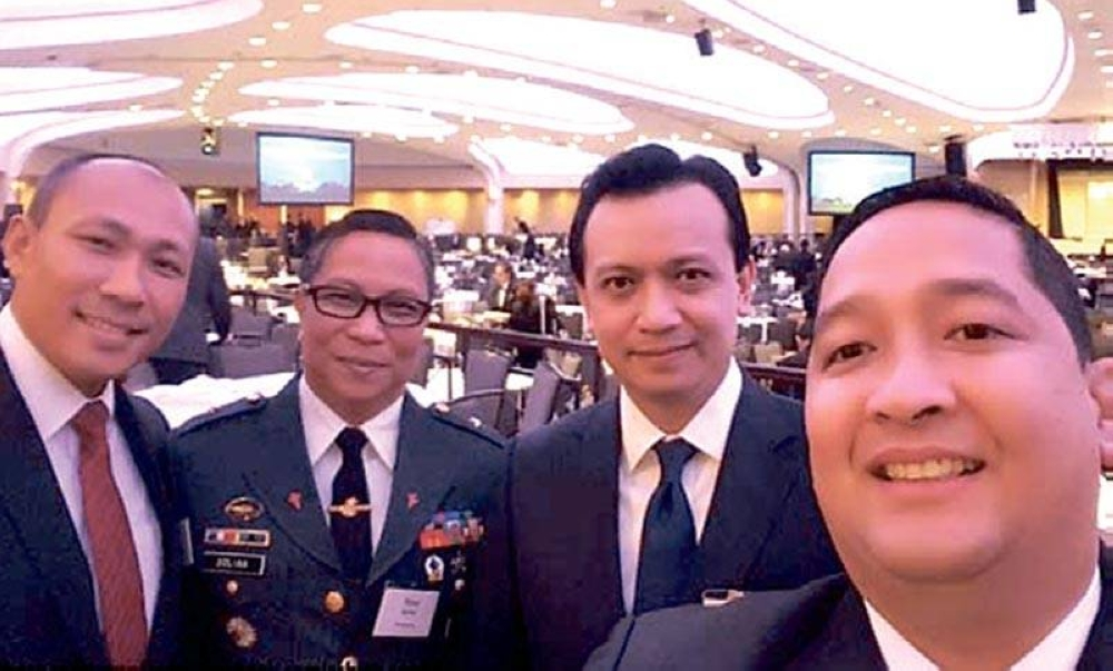 Convicted mutineer Acedillo (right) said to be behind the 'retired generals and colonels' association critical of Duterte's China policy, with comrades Trillanes and Gary Alejano in New York. FROM A FACEBOOK POST