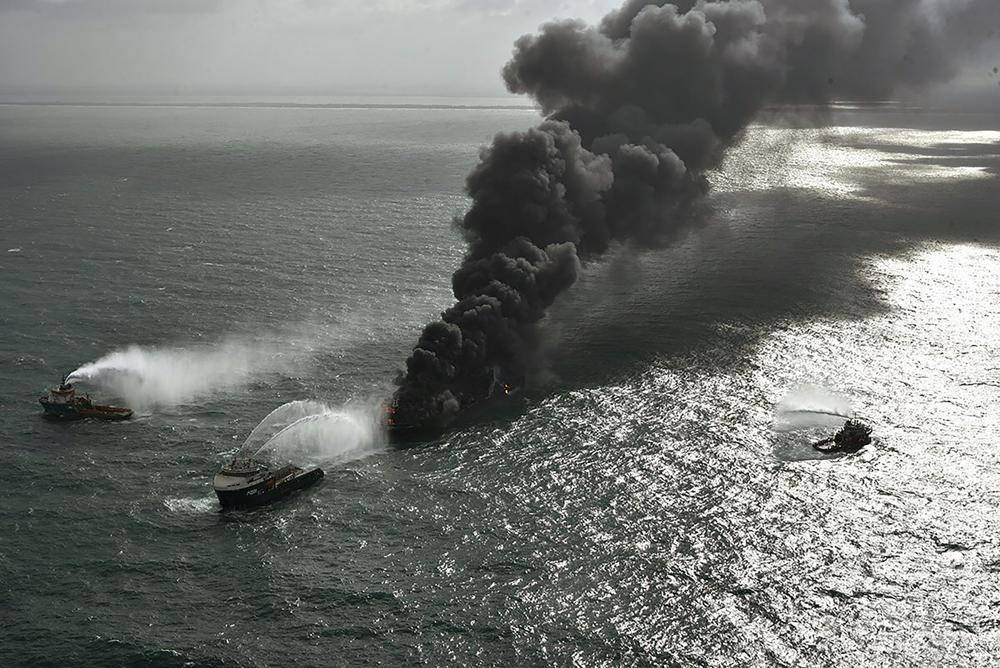 In this photo provided by Sri Lanka Air Force, smoke rises from the container vessel MV X-Press Pearl engulfed in flames off Colombo port, Sri Lanka, Wednesday, May 26, 2021. A fire on a container ship carrying chemicals raged off Sri Lanka for a sixth day Wednesday and India sent vessels to help douse the blaze, officials said. Sri Lanka Air Force via AP