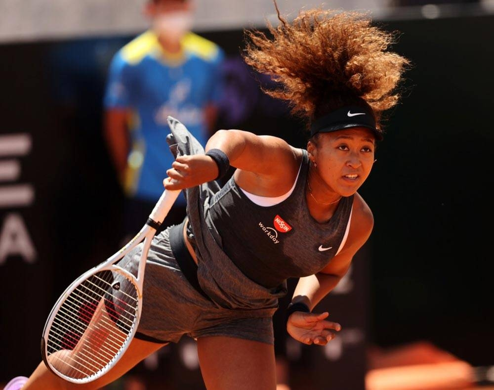 Naomi Osaka serves during a pre-French Open event in Spain. Osaka was fined after skipping the news conference at the French Open. AFP FILE PHOTO