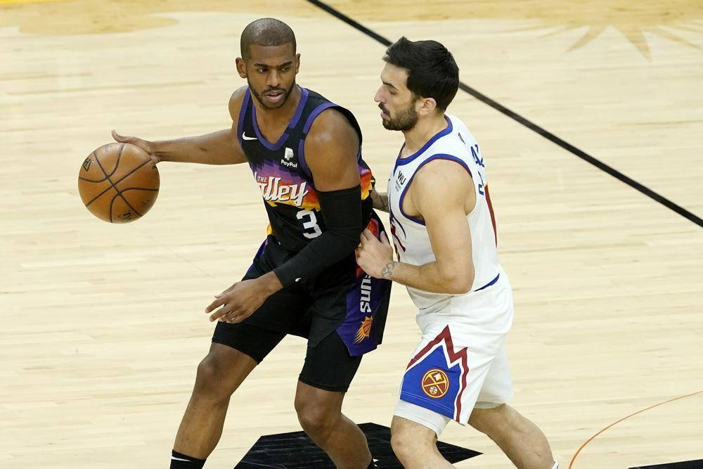 AGELESS PLAYMAKER Phoenix Suns guard Chris Paul (3) is defended by Denver Nuggets guard Facundo Campazzo during the first half of Game 2 of an NBA basketball second-round playoff series, Wednesday (Thursday in Manila) in Phoenix. AP PHOTO