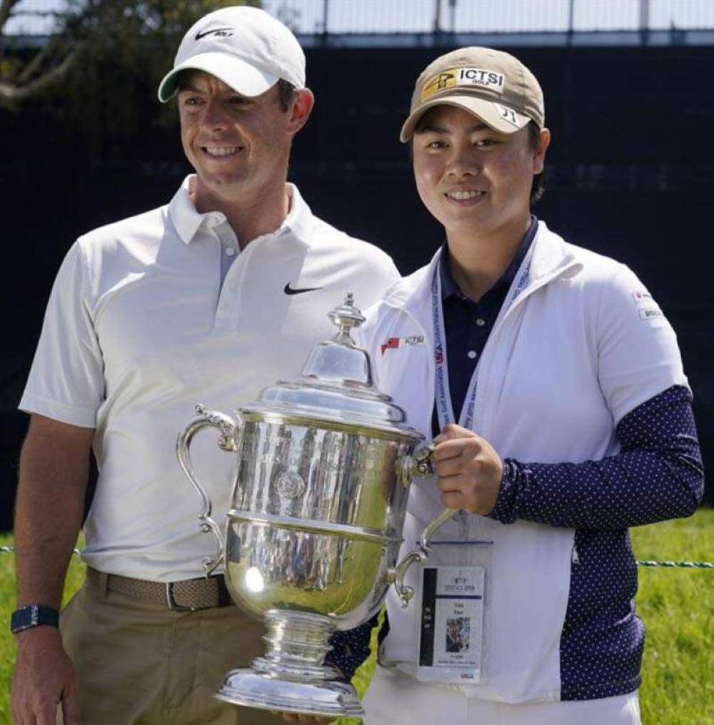 Reigning US Women's Open golf champion Yuka Saso of the Philippines poses with her champions trophy with Rory McIlroy of Northern Ireland during a practice round of the US Open Golf Championship on June 15, 2021 (June 16 in Manila) at Torrey Pines Golf Course in San Diego. AP PHOTO