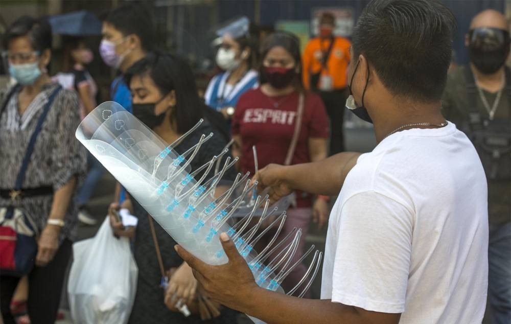 A man sells face shields in Monumento in Caloocan City on Thursday, June 17, 2021. PHOTO BY RUY MARTINEZ
