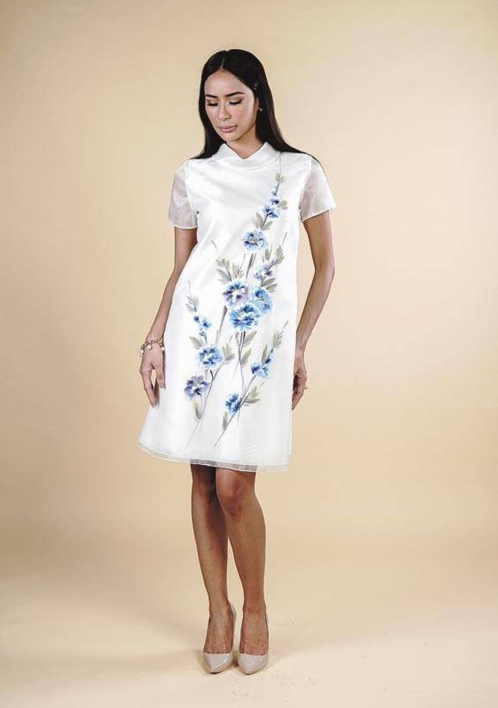 A delightful floral hand painted and hand embroidered organza dress.