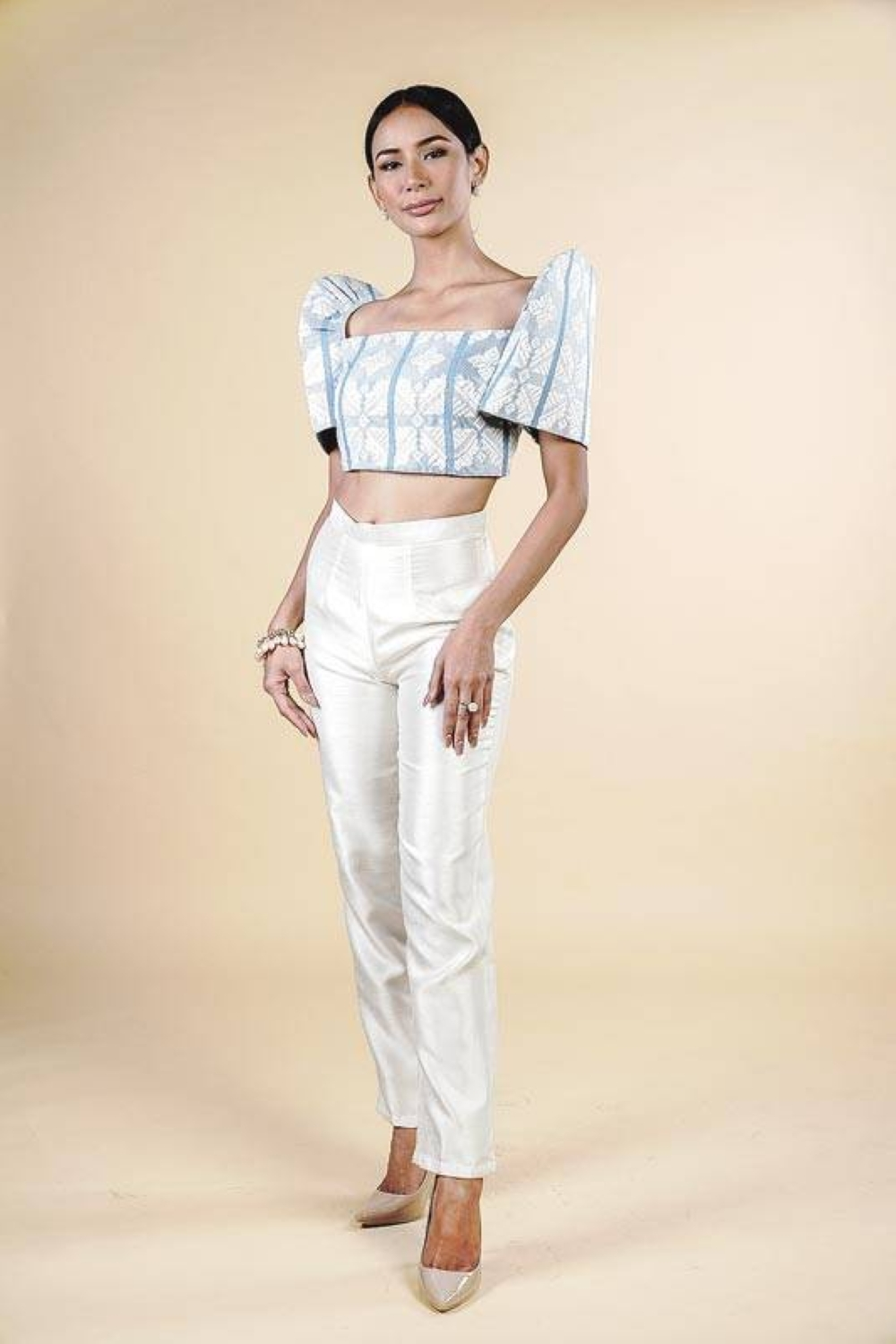 A handwoven cropped Inabel terno worn with ivory shantung silk pants.