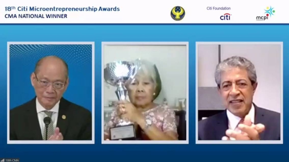 National Awardee Luzviminda Sunit (center), a dried fish microentrepreneur from Medellin, Cebu, receives the distinction from Bangko Sentral ng Pilipinas Gov. Benjamin Diokno (left) and Citi Philippines Chief Executive Officer Aftab Ahmed at the 18th Citi Microentrepreneurship Awards (CMA) virtual ceremony on June 15. PHOTO FROM THE MICROFINANCE COUNCIL OF THE PHILIPPINES INC. FACEBOOK PAGE