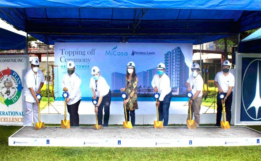 Federal Land Inc. celebrates another milestone with the topping-off ceremony of Mi Casa Hawaii Tower. The event marks the structural completion of the first tower of the development. Mi Casa is a tropical-inspired residence that features resort-style amenities and a central location within Metro Park, Federal Land's master-planned community in Bay Area. In photo are Federal Land Inc. executives and partners (from left): Aris Cuevas, DMCI vice president and head building business unit; Engr. Richard Naval, head of external construction management group; Antonino Aligaen, head of technical execution group; Cherie Fernandez, head of project development group; John Cabato, head of Metro Park and Grand Central Park township business unit; Engr. Roy Lachica, head of construction management group; and Allen Mindalano, head of Federal Land sales channel group. CONTRIBUTED PHOTO