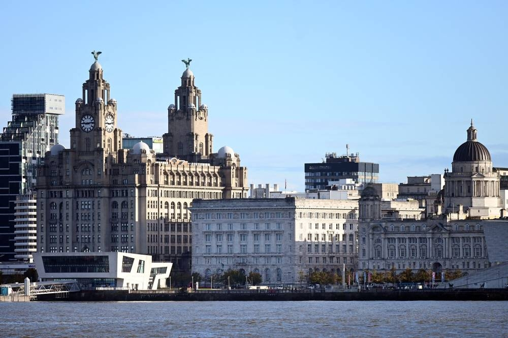 In this file photo taken on October 13, 2020 buildings on Liverpool's waterfront, including the Liver Building, are pictured across the River Mersey. AFP PHOTO