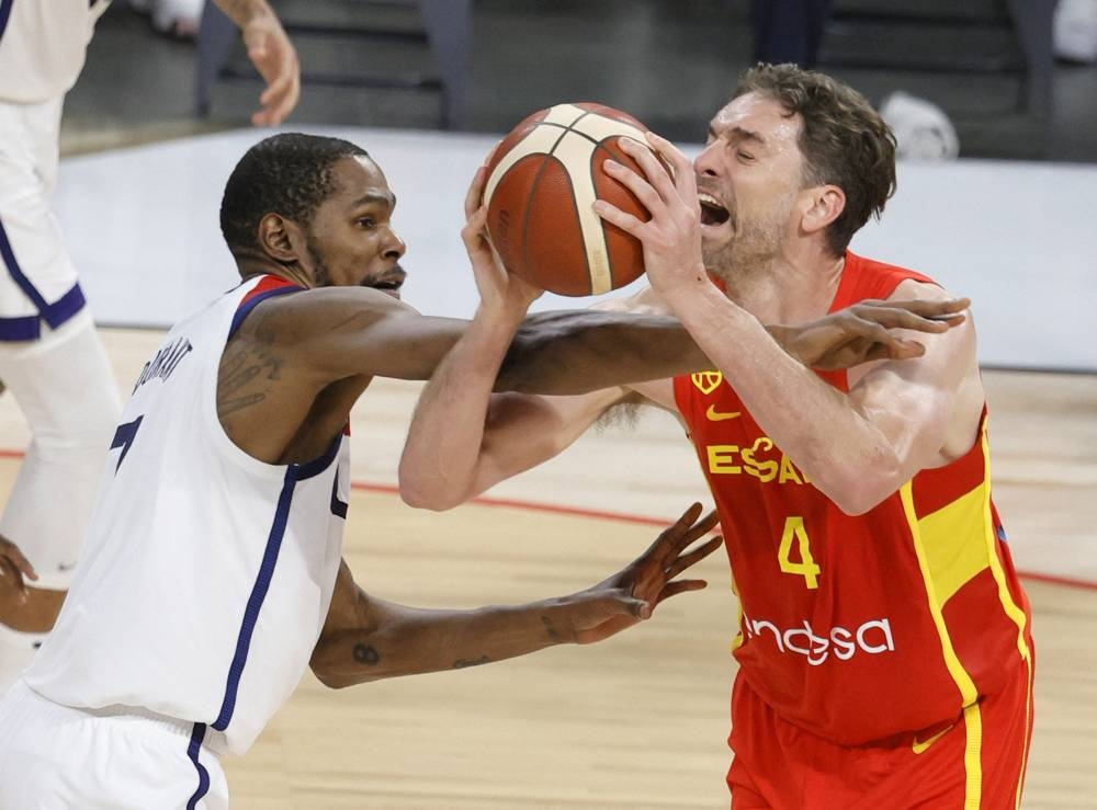 Pau Gasol #4 of Spain is fouled by Kevin Durant #7 of the United States during an exhibition game at Michelob ULTRA Arena ahead of the Tokyo Olympic Games on July 18, 2021 in Las Vegas, Nevada. The United States defeated Spain 83-76.  AFP PHOTO