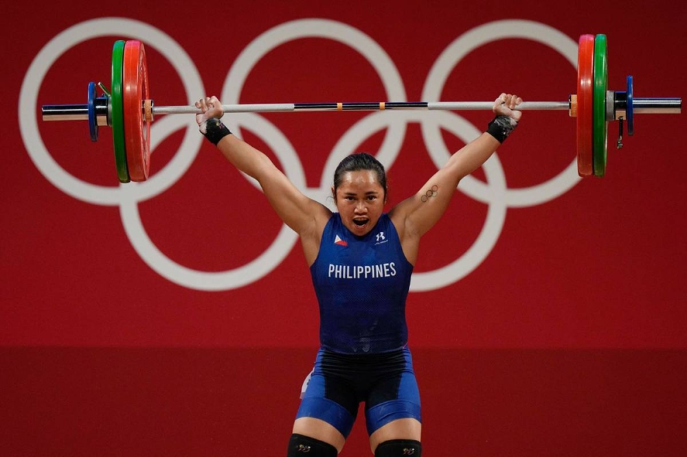 HISTORIC VICTORY Hidilyn Diaz competes in the women's 55-kg weightlifting competition at the Tokyo International Forum on July 26, 2021. AP PHOTO