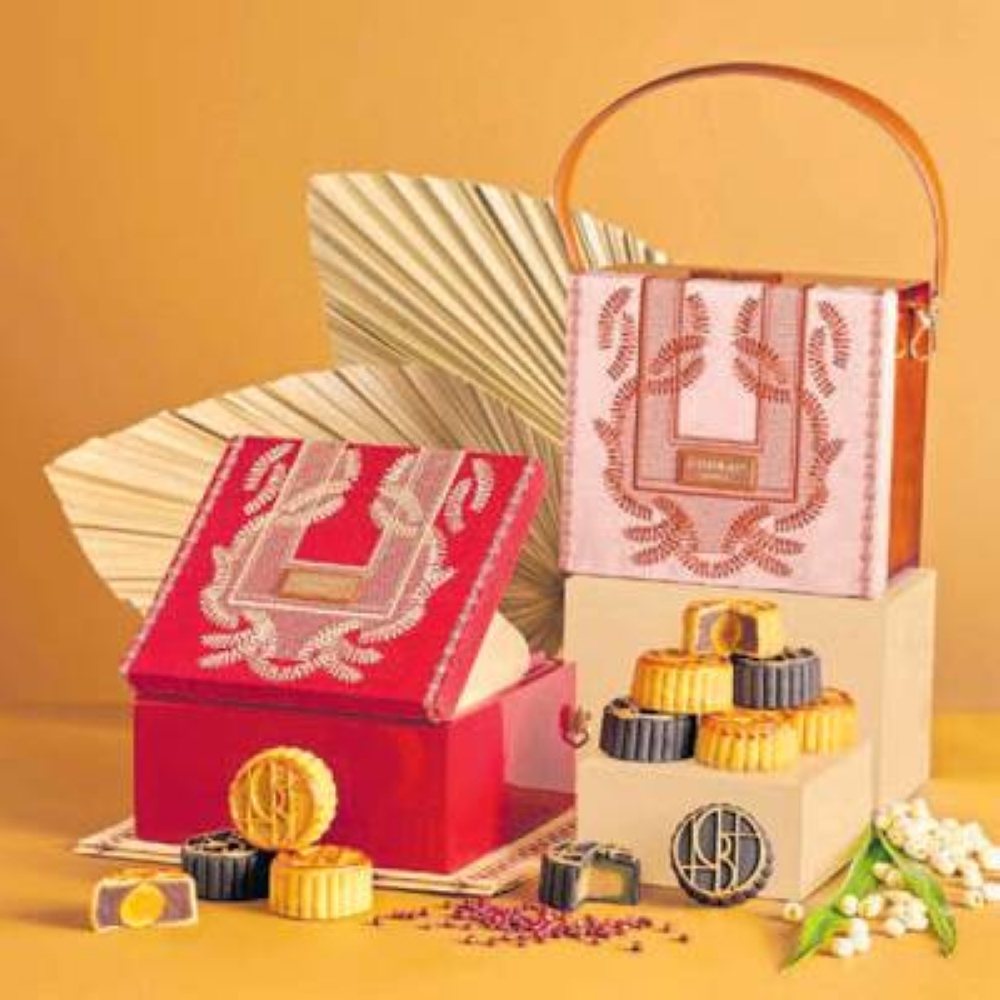 Each Harvest bag, designed by Zarah Juan, is packed with four mooncakes from the awardwinning Executive Chinese Chef Eng Yew Khor of China Blue by Jereme Leung.