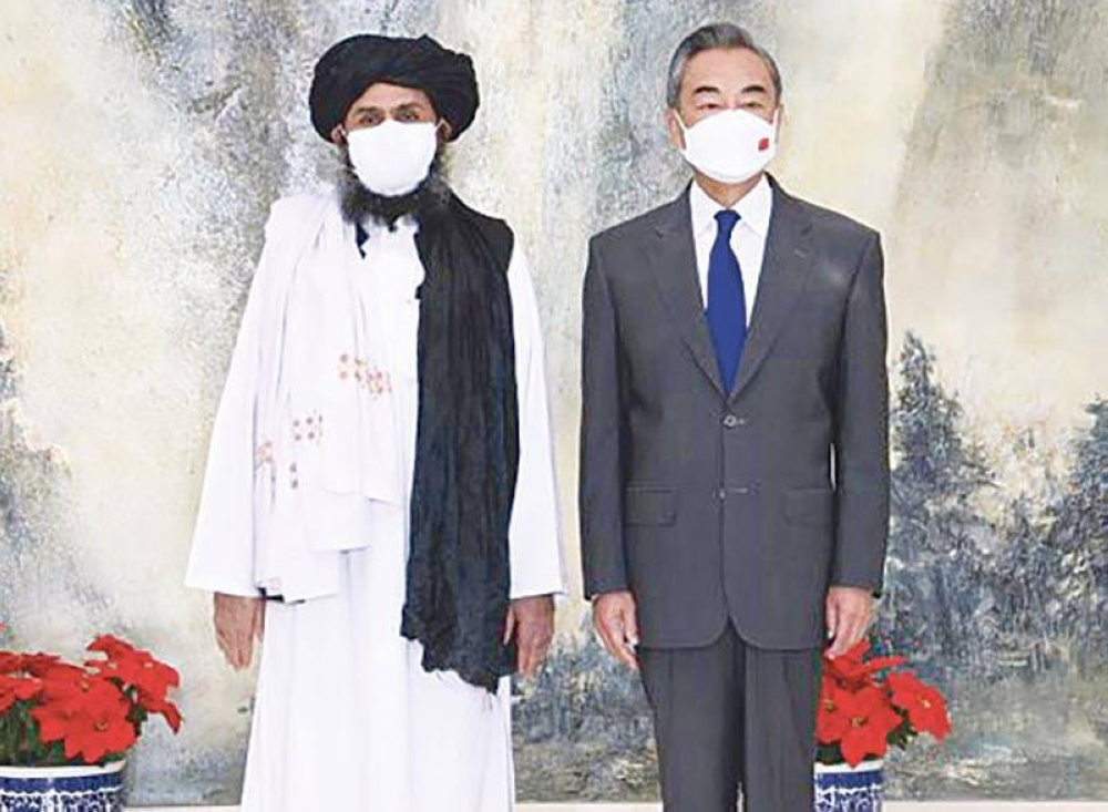 NEW ALLY? In this July 28, 2021 file photo released by China's Xinhua News Agency, Taliban cofounder Mullah Abdul Ghani Baradar (left) and Chinese Foreign Minister Wang Yi pose for a photo during their meeting in Tianjin, China. AP PHOTO