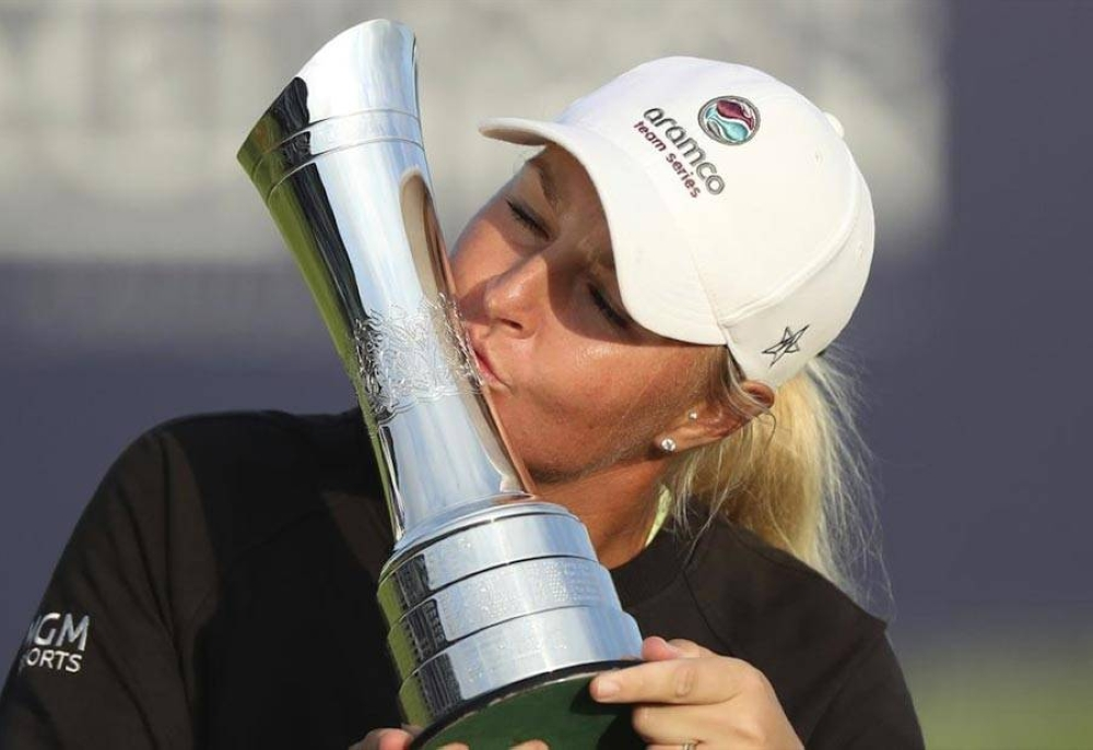 Sweden's Anna Nordqvist kisses the trophy as she poses for the media after winning the Women's British Open golf championship in Carnoustie, Scotland on August 22, 2021 (August 23 in Manila). AP PHOTO