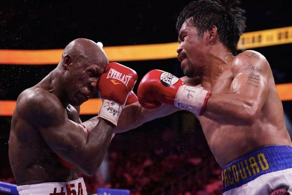 Manny Pacquiao (right) of the Philippines, hits Yordenis Ugas of Cuba in a welterweight championship boxing match on August 21, 2021 (August 22 in Manila) in Las Vegas. AP PHOTO