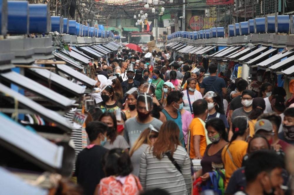 BUSINESS AS USUAL People crowd stalls in Divisoria, Manila, the country's bargain center, as businesses again reopened after quarantine restrictions were eased in Metro Manila. PHOTO BY J. GERARD SEGUIA