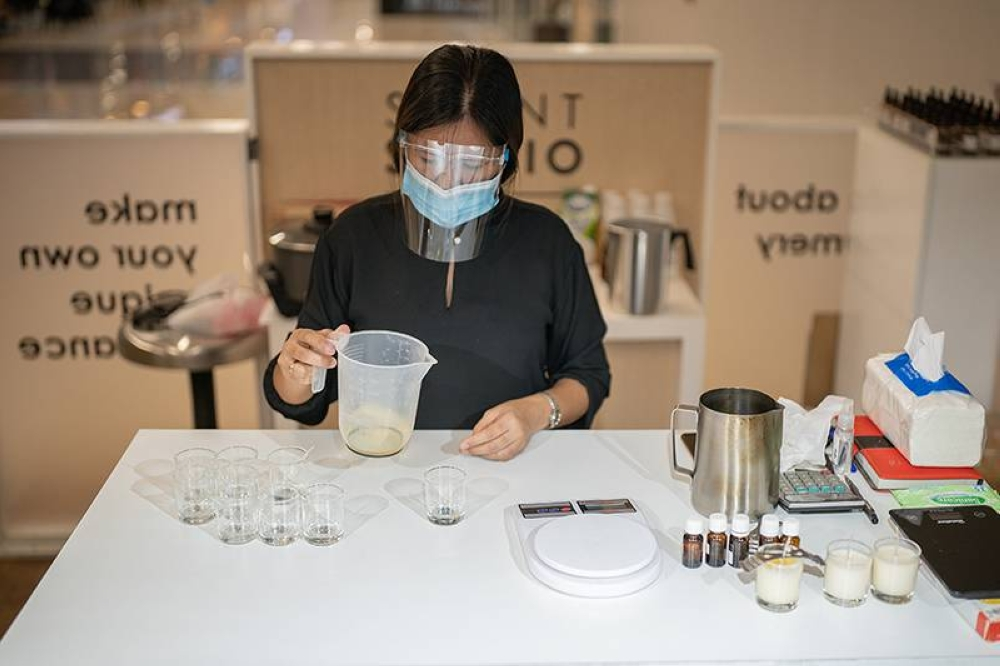 A Bernadette employee in the perfume workshop (above) and the perfume specialist (right) in the showroom.  CONTRIBUTED PHOTOS