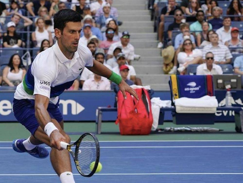 Novak Djokovic returns a shot to Kei Nishikori during the third round of the US Open tennis championships on Sept. 4, 2021 (September 5 in Manila) in New York. AP PHOTO