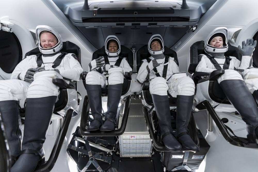 In this Sunday, Sept. 12, 2021 photo made available by SpaceX (from left) Chris Sembroski, Sian Proctor, Jared Isaacman and Hayley Arceneaux sit in the Dragon capsule at Cape Canaveral in Florida, during a dress rehearsal for the upcoming launch. SPACEX VIA AP