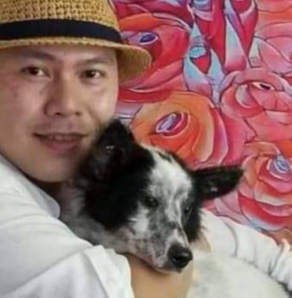 Painter Rommel Rico in a fundraising project.