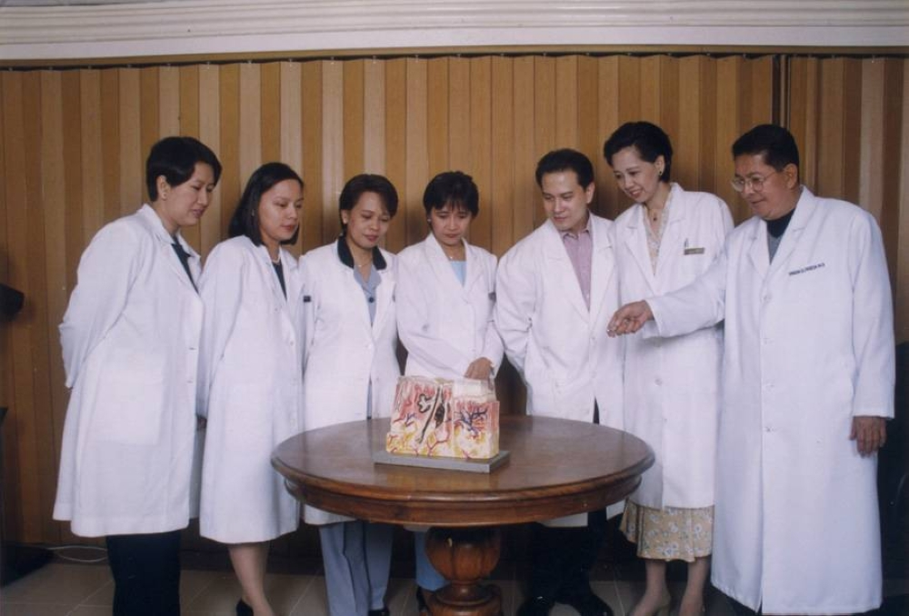 The Dermclinic founder (rightmost) and lecturing to his staff about hair and scalp treatment. CONTRIBUTED PHOTOS
