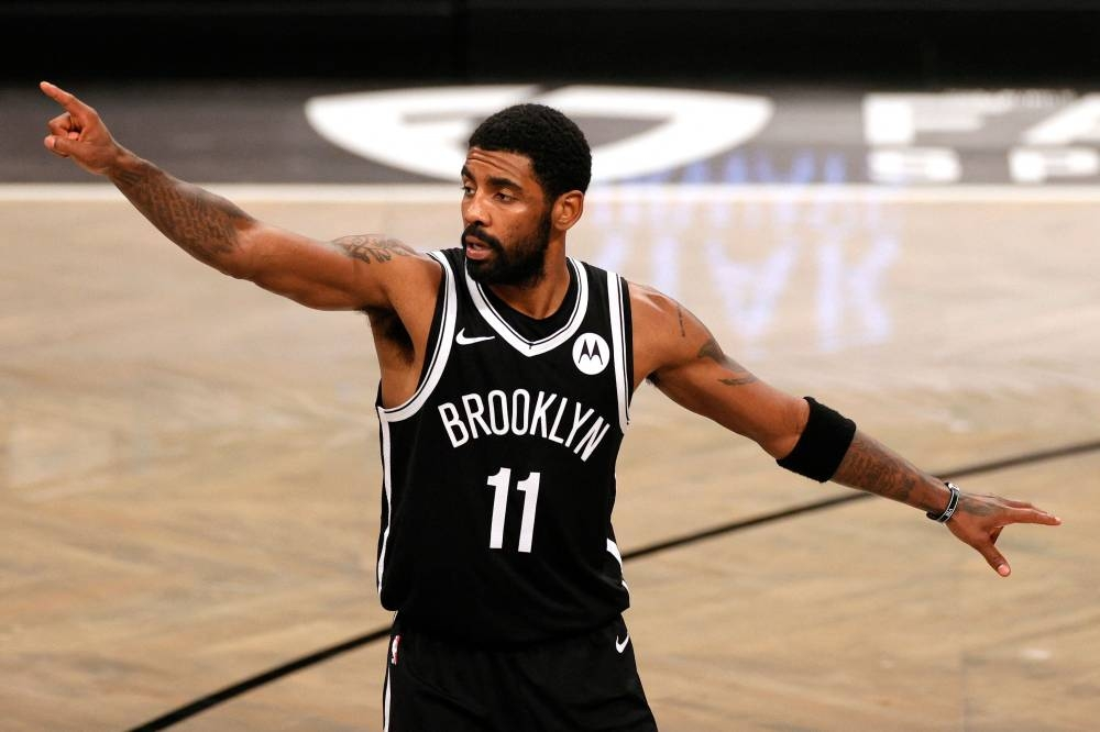 In this file photo taken on January 1, 2020 Kyrie Irving #11 of the Brooklyn Nets points during the second half against the Atlanta Hawks at Barclays Center in the Brooklyn borough of New York City. AFP PHOTO
