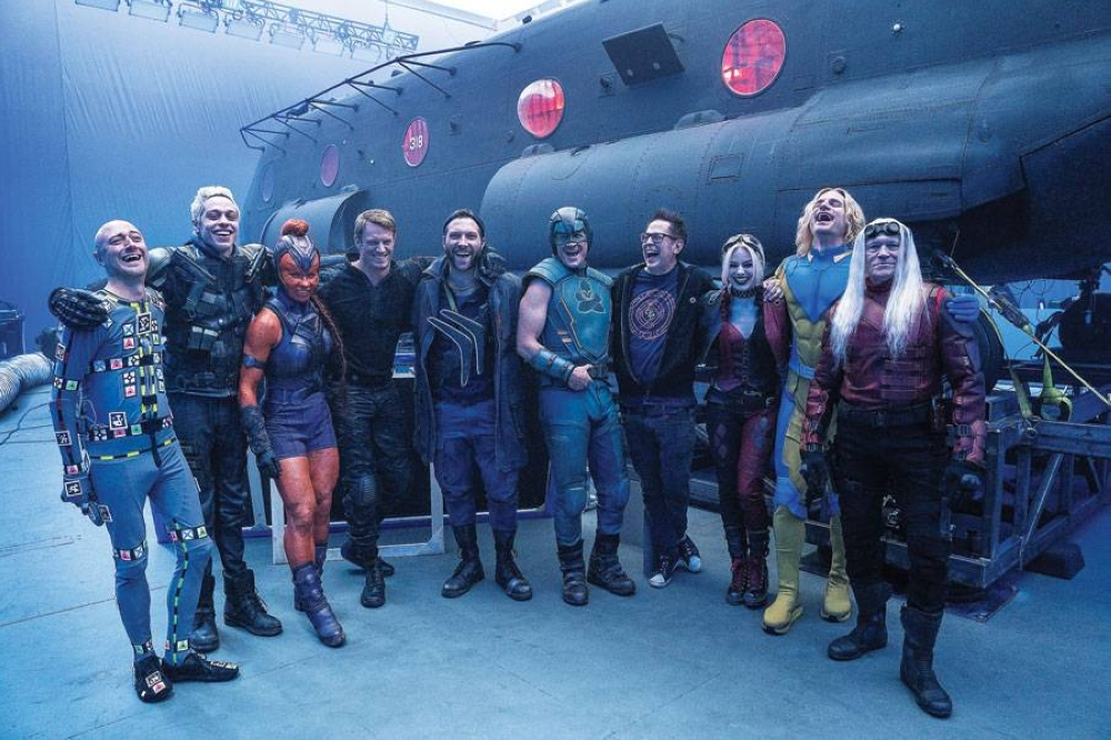 The Suicide Squad is all laughs in this behind the scenes photo on set. Well, maybe with the exception of Savant (Michael Rooker, rightmost).